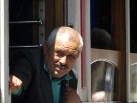 happy tram conductor