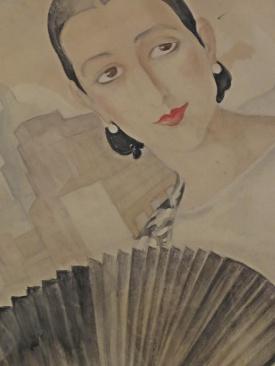 woman with black fan